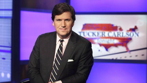 Tucker Carlson, host of Tucker Carlson Tonight, poses for photos in a Fox News Channel studio, in New York, Thursday, March 2, 2107. - Sputnik International