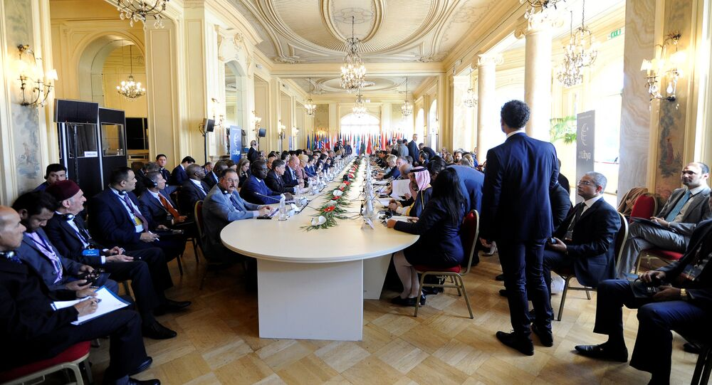 Participants attend the second day of the international conference on Libya in Palermo, Italy, November 13, 2018