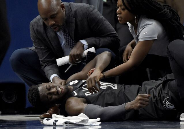 Brooklyn Nets guard Caris LeVert (22) is tended to after an injury during the second quarter of an NBA basketball game against the Minnesota Timberwolves on Monday, Nov. 12, 2018, in Minneapolis