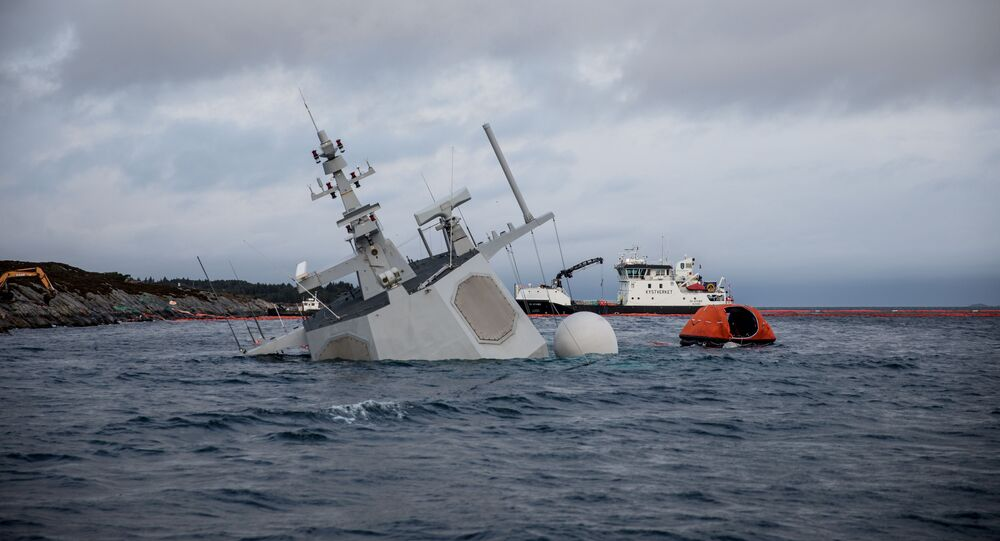A shipwrecked Norwegian navy frigate KNM Helge Ingstad is seen in this Norwegian Coastal Administration handout picture in Oygarden, Norway, November 13, 2018