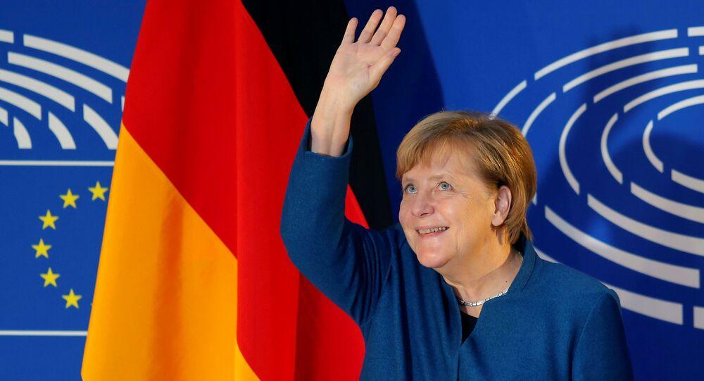 German Chancellor Angela Merkel waves as she arrives to address the European Parliament in Strasbourg, France, November 13, 2018