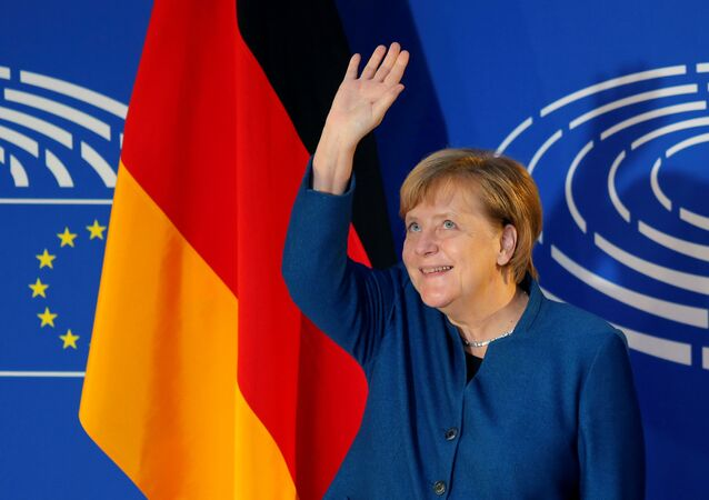 German Chancellor Angela Merkel waves as she arrives to address the European Parliament in Strasbourg, France, November 13, 2018