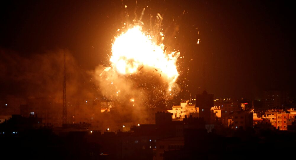 An explosion is seen during an Israeli air strike on Hamas's television station, in Gaza City November 12, 2018.