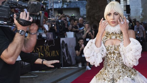 Actress and singer Lady Gaga poses for photographers upon arrival at the premiere of the film 'A Star Is Born' in London, 27 September 2018.  - Sputnik International