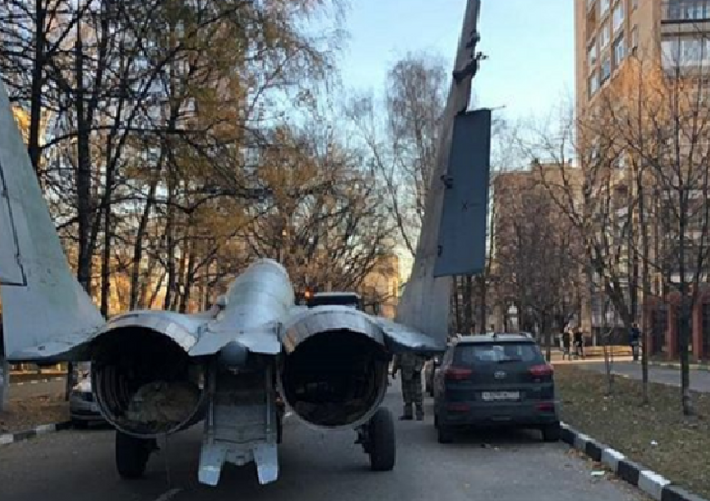 MiG-29 being driven through a street in Moscow suburb.