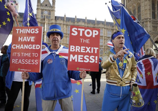 Anti-Brexit demonstrators protest outside Parliament as British PM Theresa May was attending Prime Minister's questions in London, Wednesday, Nov. 14, 2018