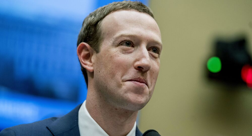 In this April 11, 2018 file photo, Facebook CEO Mark Zuckerberg pauses while testifying on Capitol Hill in Washington