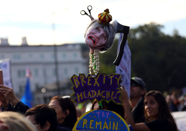 Protesters participating in an anti-Brexit demonstration, carry an effigy of Britain's Prime Minister Theresa May, as they march through central London, Britain October 20, 2018