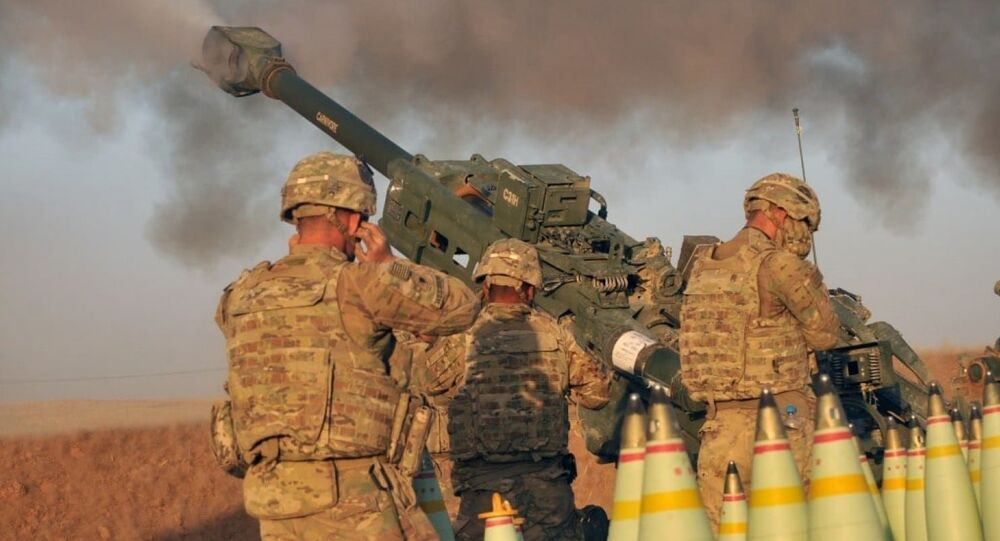 U.S. Army soldiers with Battery C, 1st Battalion, 320th Field Artillery Regiment, Task Force Strike, execute a fire mission in northern Iraq on Aug. 14 2016
