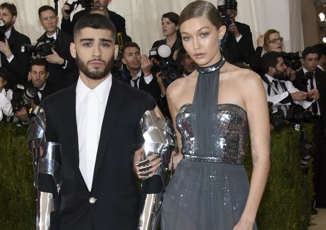 In this 2 May 2016 file photo, Zayn Malik, left, and Gigi Hadid arrive at The Metropolitan Museum of Art Costume Institute Benefit Gala in New York.