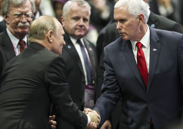 Russian President Vladimir Putin shakes hands with US Vice-President Mike Pence as Trump National Security Adviser John Bolton looks on.