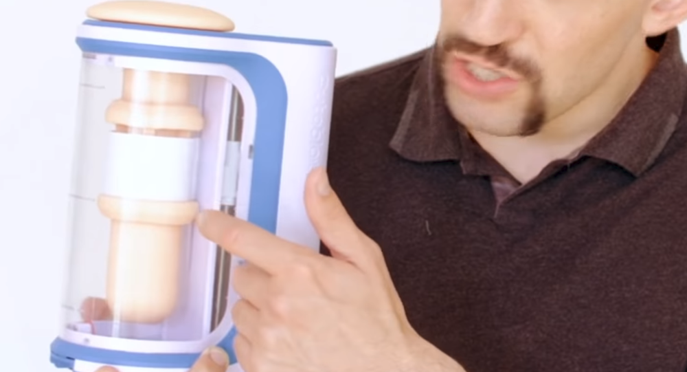 Autoblow AI inventor Brian Sloan displays his invention, the world's first oral sex robot