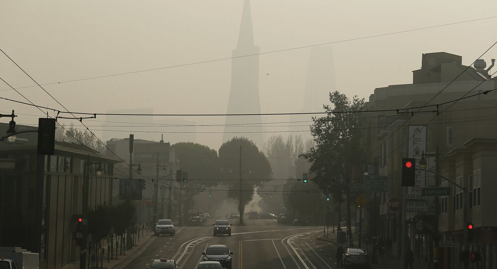 The Transamerica Pyramid is obscured by smoke and haze from wildfires Friday, Nov. 16, 2018, in San Francisco.