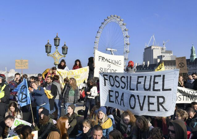 Demonstrators on Westminster Bridge in London, Saturday Nov. 17, 2018, for a protest group called 'Extinction Rebellion' to raise awareness of the dangers posed by climate change. Hundreds of protesters turned out in central London and blocked off the capital's main bridges to demand the government take climate change seriously