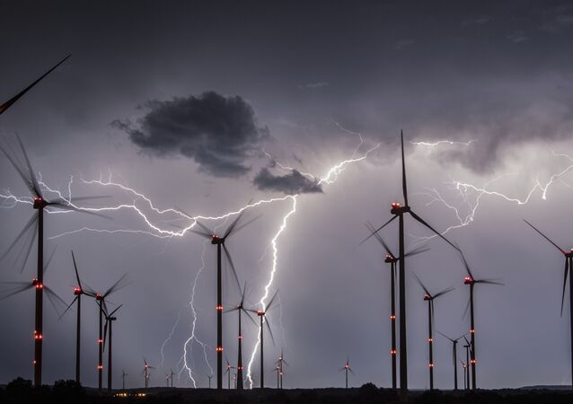 In this Aug. 1, 2017 photo lightning illuminate the night sky over the Odervorland wind farm in the Oder-Spree district near to Sieversdorf, Germany.