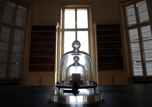 A replica of the International Prototype Kilogram is pictured at the International Bureau of Weights and Measures, in Sevres, near Paris