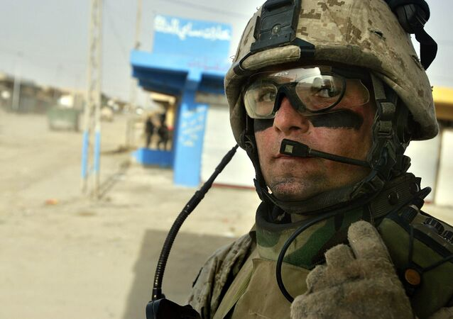 U.S. Marine Sgt. Derek McGee, of Rhinebeck, New York, speaks into his radio during a patrol in Fallujah, the site of the largest U.S. battle in Iraq, 65 kilometers (40 miles), west of Baghdad, Iraq, Monday, May 1, 2006