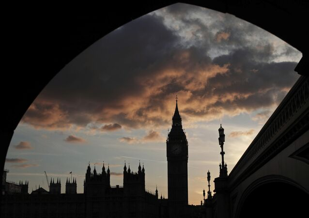 A silhouette of the Houses of Parliament and Elizabeth Tower containing Big Ben, center, at dusk, in Westminster, London