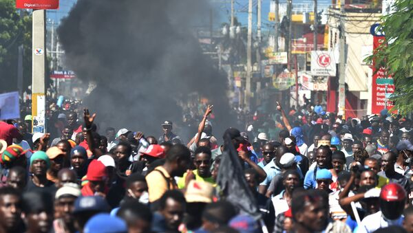Demonstrators march during a protest demanding accountability from politicians for allegedly squandering billions of dollars in proceeds from Venezuela's discounted PetroCaribe oil program in the streets of Port-au-Prince, on November 18, 2018, Investigations by the Haitian Senate in 2016 and 2017 concluded that nearly $2 billion from a Venezuelan aid program called Petrocaribe were misused. Through Petrocaribe, Venezuela for years supplied Haiti and other Caribbean and Central American countries with oil at cut-rate prices and on easy credit terms. - Sputnik International