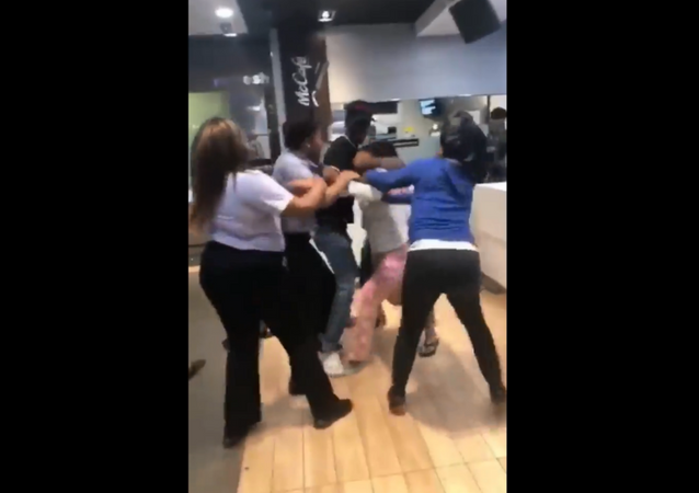 Recently surfaced cell phone footage shows the moment two brawl unfold at a McDonald's restaurant in Louisiana
