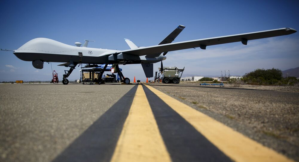 A General Atomics MQ-9 Reaper stands on the runway during Black Dart, a live-fly, live fire demonstration of 55 unmanned aerial vehicles, or drones, at Naval Base Ventura County Sea Range, Point Mugu, near Oxnard, California July 31, 2015