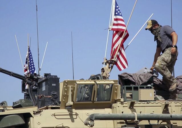 American soldier standing on an armored vehicle