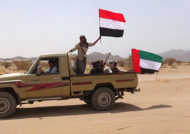 Yemeni tribesmen from the Popular Resistance Committees, supporting forces loyal to Yemen's Saudi-backed fugitive President Abedrabbo Mansour Hadi, hold the Emirati (R) and Yemeni flag as they drive in Marib province, east of the Yemeni capital, Sanaa, on September 20, 2015