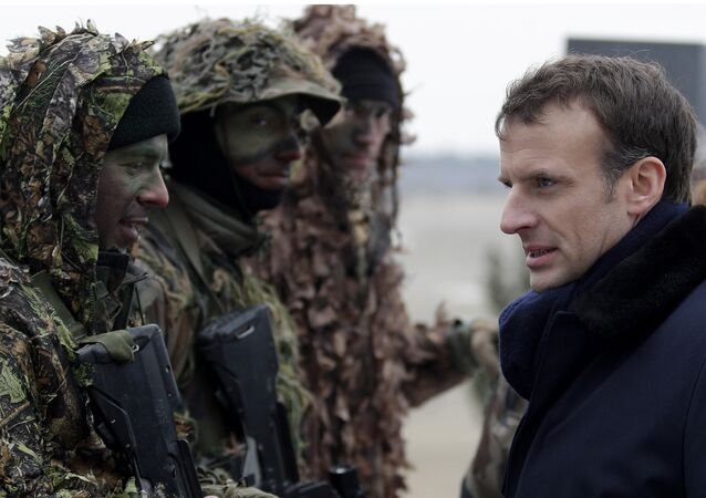 French President Emmanuel Macron inspects sniper squad as he attends a military exercise at the military camp of Suippes, near Reims, eastern France, Thursday, March 1, 2018