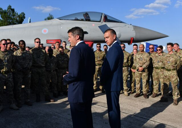 British Defence Minister Gavin Williamson (L) and his Romanian counterpart Mihai Fifor (R), meet with the British pilots and technical staff serving the four British Air Force Typhoons and the Romanian military personnel at Mihail Kogalniceanu 57 Air Base near Constanta, Romania on August 2, 2018.