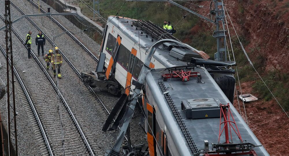 Rescue workers survey the scene after a commuter train derailed between Terrassa and Manresa, outside Barcelona, Spain, November 20, 2018