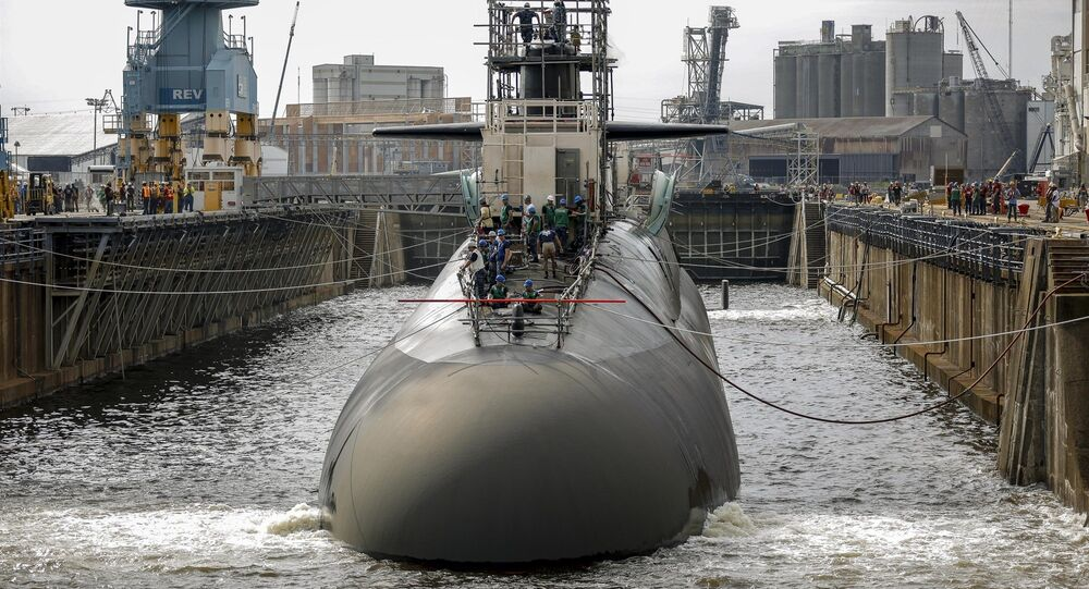 A submarine in one of the Norfolk Naval Shipyard's dry docks, which can be pumped dry to allow repairs on a vessel