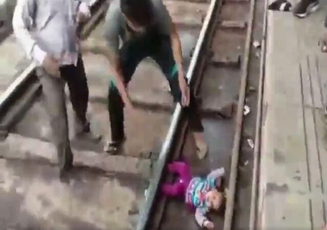 One-year-old girl escapes unhurt after a train runs over her at Mathura Railway station