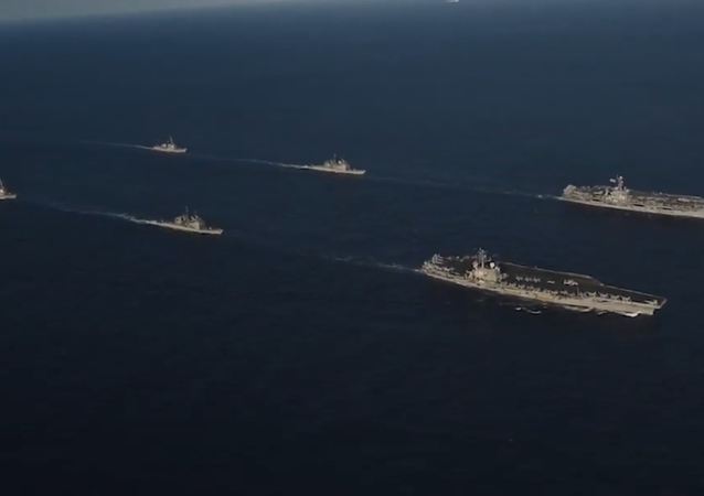US Navy aircraft carriers John C. Stennis and Ronald Reagan drill with their battle groups in the Philippine Sea