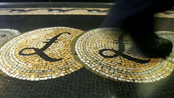 An employee is seen walking over a mosaic of pound sterling symbols set in the floor of the front hall of the Bank of England in London - Sputnik International