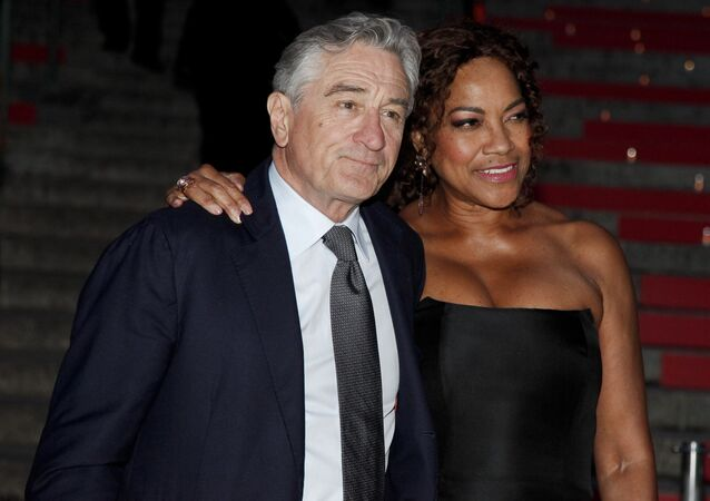 Robert De Niro, left, and Grace Hightower, right, attend the annual Vanity Fair Tribeca Film Festival kick-off party at the State Supreme Courthouse on Tuesday, April 14, 2015, in New York