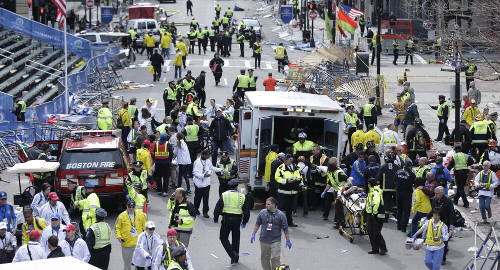 Medical workers aid injured people at the finish line of the 2013 Boston Marathon following an explosion in Boston, Monday, April 15, 2013
