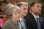 Britain's Prime Minister Theresa May sits next to Chancellor of the Ecxhequer Philip Hammond, and Health Secretary Jeremy Hunt during an event at the Royal Free Hospital, London June 18, 2018