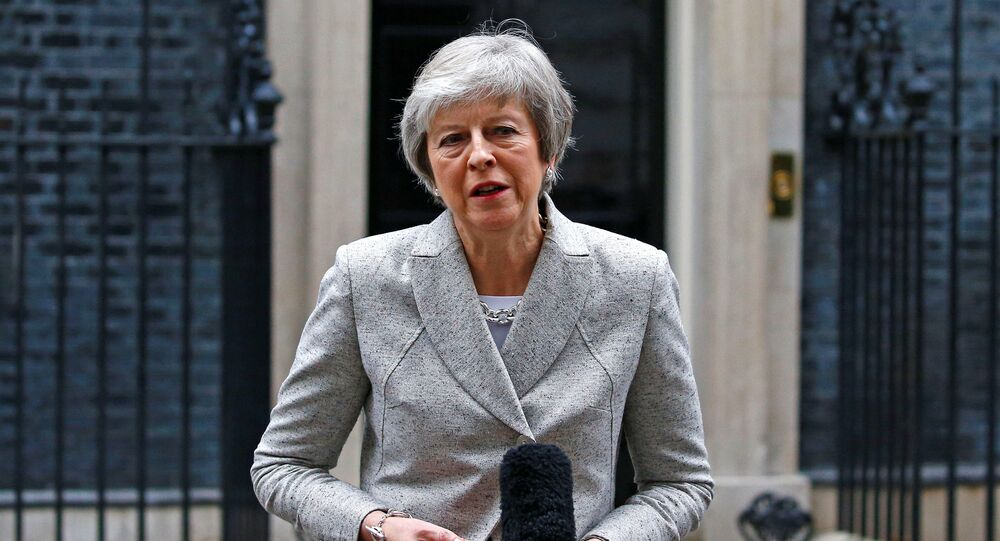 Britain's Prime Minister Theresa May addresses the media outside 10 Downing Street in London, Britain, November 22, 2018.