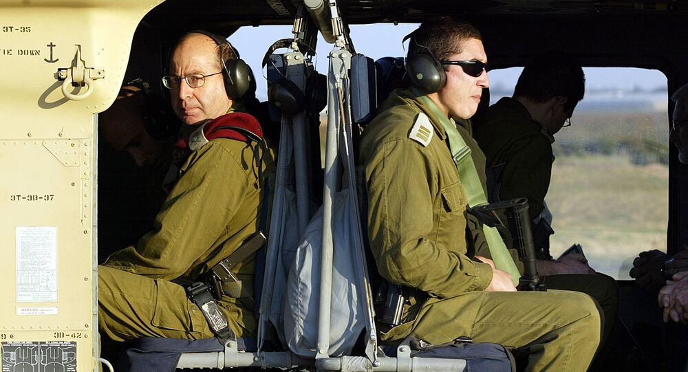 Moshe Yaalon (L) is seen on board of a Black Hawk helicopter with one of his bodyguards (R). File photo
