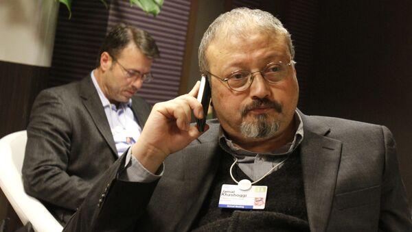 FILE - In this Jan. 29, 2011 file photo, Saudi journalist Jamal Khashoggi speaks on his cellphone at the World Economic Forum in Davos, Switzerland. Khashoggi was a Saudi insider - Sputnik International