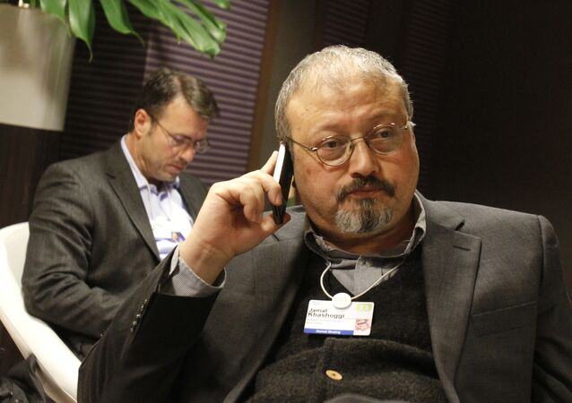 FILE - In this 29 January 2011 file photo, Saudi journalist Jamal Khashoggi speaks on his cellphone at the World Economic Forum in Davos, Switzerland.