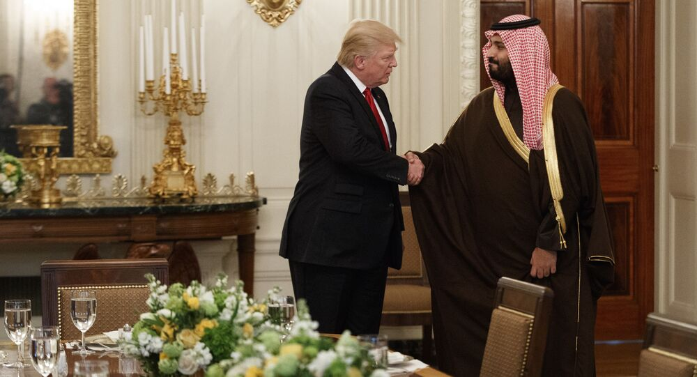 In this March 14, 2017 photo, US President Donald Trump shakes hands with Saudi Defense Minister and Deputy Crown Prince Mohammed bin Salman, in the State Dining Room of the White House in Washington
