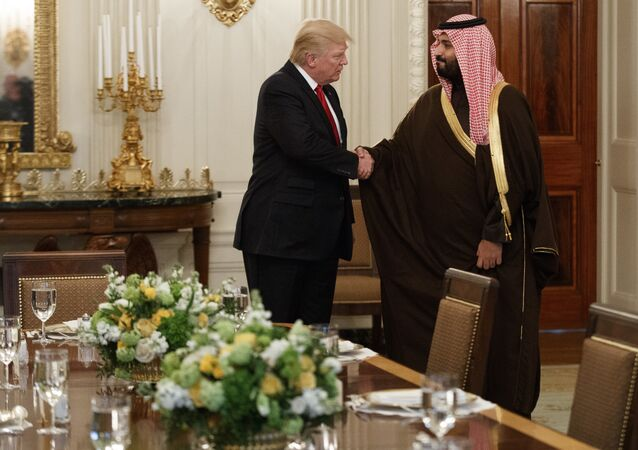 DAY 54 - In this March 14, 2017, file photo, President Donald Trump shakes hands with Saudi Defense Minister and Deputy Crown Prince Mohammed bin Salman, in the State Dining Room of the White House in Washington