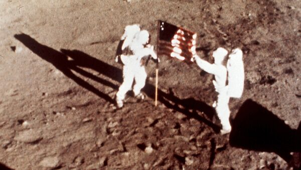 Apollo 11 astronauts Neil Armstrong and Edwin E. Buzz Aldrin, the first men to land on the moon, plant the U.S. flag on the lunar surface, July 20, 1969. Photo was made by a 16mm movie camera inside the lunar module, shooting at one frame per second - Sputnik International