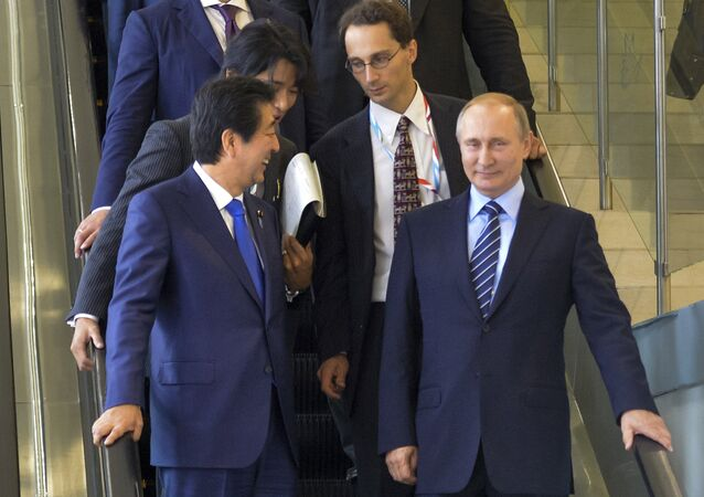 Japanese Prime Minister Shinzo Abe, left, and Russian President Vladimir Putin come down on the escalator after their talks in Vladivostok, Russia, Friday, Sept. 2, 2016