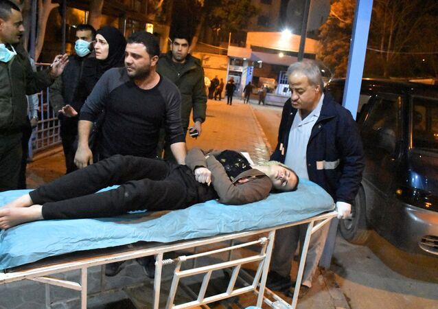 A woman lies on a stretcher after what the Syrian state media said was a suspected toxic gas attack in Aleppo, Syria November 24, 2018