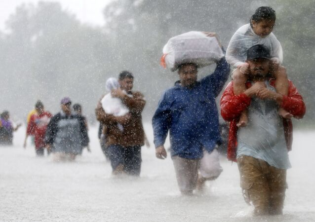 Residents wade through flood waters from Tropical Storm Harvey in Beaumont Place, Houston, Texas, U.S., on August 28, 2017