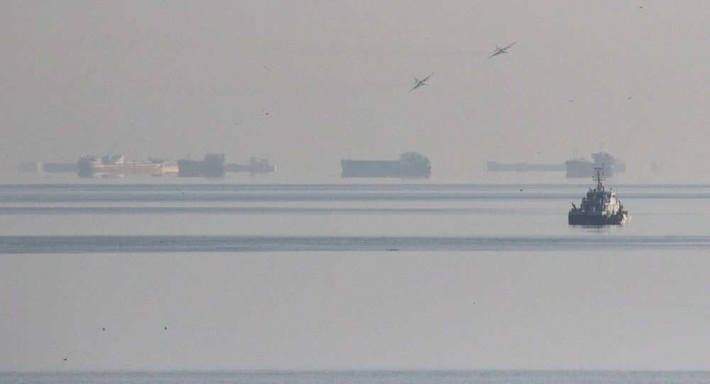 Russian jet fighters fly over vessels after the channel beneath a bridge connecting the Russian mainland with the Crimean Peninsula was blocked November 25, 2018