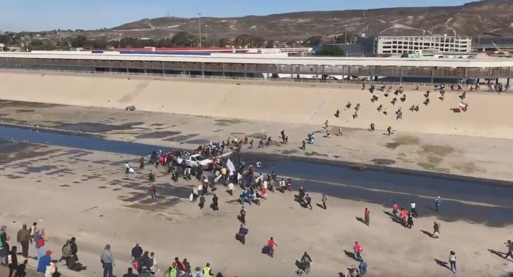 Migrants reportedly attempting to storm U.S.-Mexico border