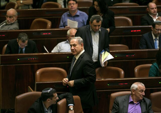 Israel's Prime Minister Benjamin Netanyahu leaves after a vote to dissolve the Israeli parliament, also known as the Knesset, in Jerusalem December 8, 2014